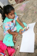 colores and paper were the gift for the performing children