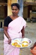 Jayalakshmi serves snacks