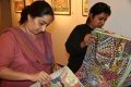 Darshan Shah (on the right), owner of the gallery, looking through the pile of Bindu art