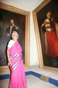 Lakshmiammal infront of monumental paintings