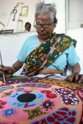 Lakshmiammal working on her Bindu art