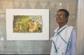 Damodaran in front of his painting -  photo by Ian Watkinson