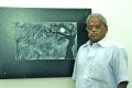 B. Ramachandran in front of his painting