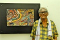 Eswaran stands proud in front of his painting