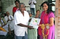 Vadivel hand over the present from the students to Padma