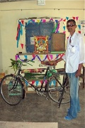 Udaya Kumar with his blessed bicycle.jpg