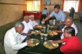 The guests effected by leprosy enjoying to be served at lunch