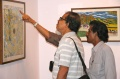 Guests looking at the art works
