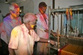 Subiah, Vadivel and Kumar fascinated about the weaving looms