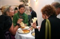 Guests enjoying the Indian food after the opening