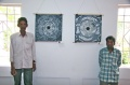 Kumar and Balachandran in front of their paintings