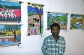 Balachandran stands proud in front of his painting