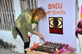 Tia Pleiman cutting the Bindu birthday cake