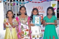 Girls from Bharathapuram getting presents for their performance