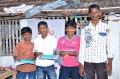 Boys from Bharathapuram getting presents for their performance.jpg