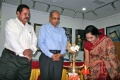 Padma Venkataraman lighting the lamp