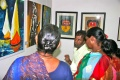 Bindu-Students discussing the displayed paintings