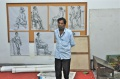 P. Balachandran lshows his paintings on his mobile